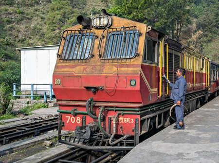 Narrow gauge Kalka to Shimla Shivalik Deluxe express halts at Barog as station staff completes the formalities with crew.