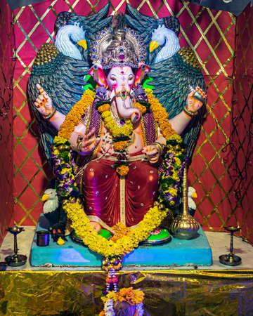 Closeup , portrait view of decorated and garlanded  idol of Hindu God Ganesha in Pune ,Maharashtra, India. Stockfoto