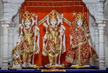 Close up of decorated idols of Hindu Gods Ram, Lakshman & Goddess Sita together in a temple at Somnath, Gujarat, India.