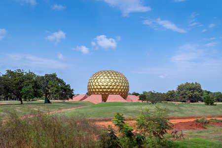 Golden dome of Matrimandir - an edifice of spiritual significance for practitioners of Integral yoga, in the center of Auroville ,Pondicherry,India.