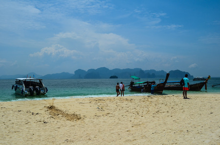 Boats on beach at Poda Island in Krabi, Thailand. One destinations in 4 Islands Tour.