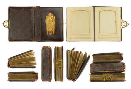 coining: Different perspectives of vintage photo album (circa 1900) with buckle and brass engraved decoration, isolated on white, contains working paths Stock Photo