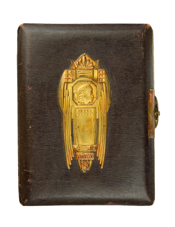 coining: Vintage photo album cover circa 1900 with buckle and brass engraved decoration, isolated on white