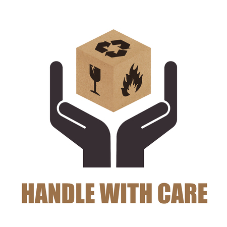Handle with Care packaging symbols on cardboard box.