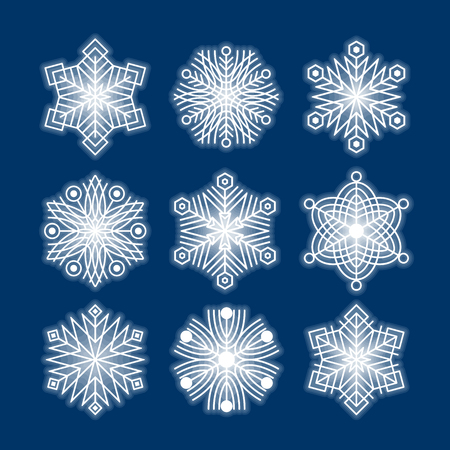 Set of white snowflakes silhouettes isolated on dark blue background, vector EPS10. Flat snow icons for christmas cards, banners, wrapping paper. Winter holiday Xmas or New Year 2019 decoration