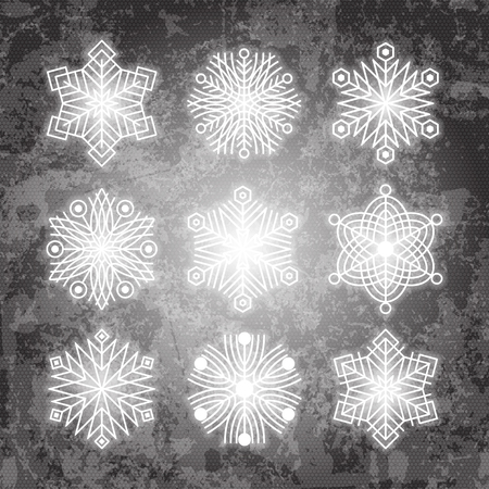 Set of white snowflakes silhouettes isolated on abstract