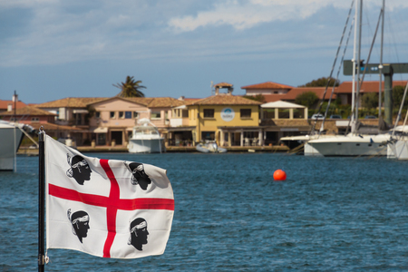 The flag of Sadinia on the sardinian coast Costa Smeralda, Italy Banco de Imagens