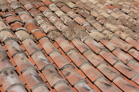 Old roof tiles background. Architectural element in Mediterranean style