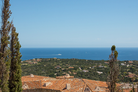 Costa Smeralda landscape with a view on roofs and the sea coast. Sardinia island, Italy