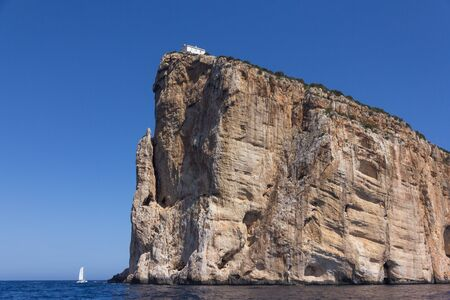 View from the sea on Cape Capo Caccia on the way to Neptune Cave, near Alghero city of Sardinia, Italy
