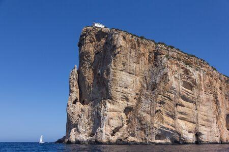 View from the sea on Cape Capo Caccia on the way to Neptune Cave, near Alghero city of Sardinia, Italy 版權商用圖片 - 130745474