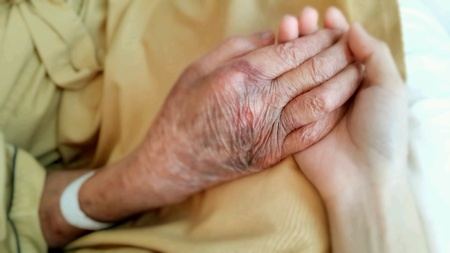 man: Hand of old man hold with younger hand