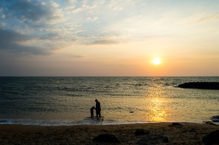 girls at the beach series: father and daughter at beach sun set