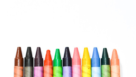 multicolored: Multicolored crayons on white background Stock Photo