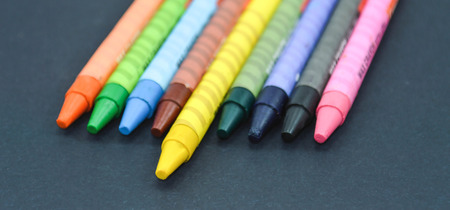 crayons: Multicolored crayons on black background