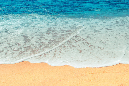 stormy waters: Soft wave of the sea on the sandy beach Stock Photo