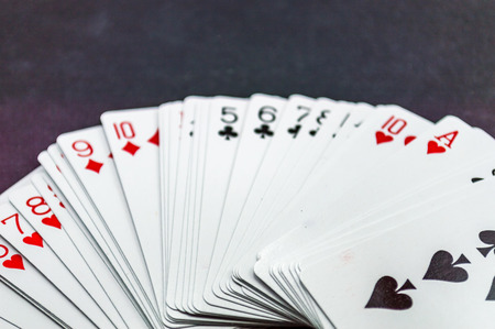 hand holding playing card: royal flush Stock Photo