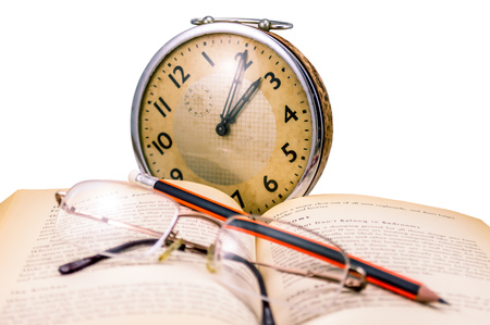 greek alphabet: book glasses, pencil an old clock -  reading in old age. Stock Photo