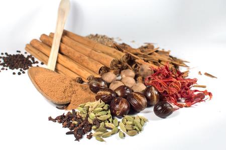 cardamon: Cardamon, cloves, Black pepper, white pepper, cinnamon, cinnamon power,nutmeg,mace Stock Photo