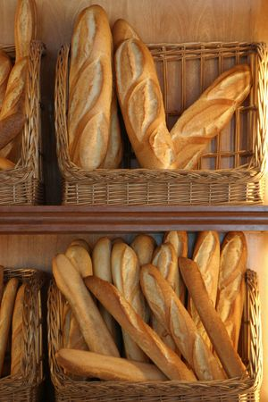 French loaves for sale in a bakery. Stock Photo