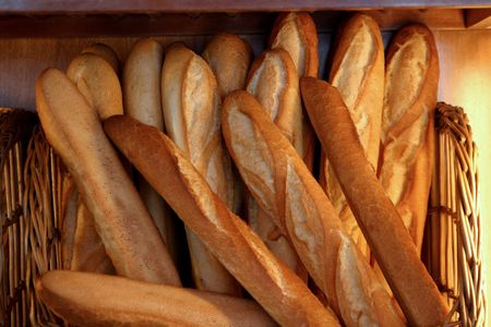 spongy: French loaves for sale in a bakery. Stock Photo