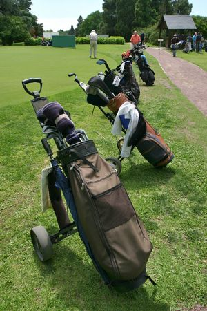 Several golf bags on a golf course. Stock Photo