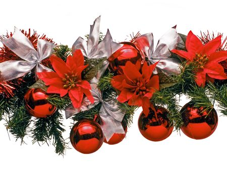 festividad: Christmas decoration with white bows, balls, red flowers and bunches of green pine needles on a white background. Stock Photo
