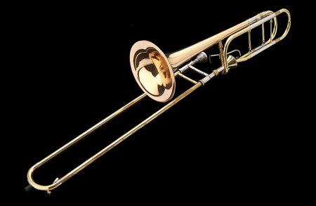 trombone:  Brass slide trombone on a black background