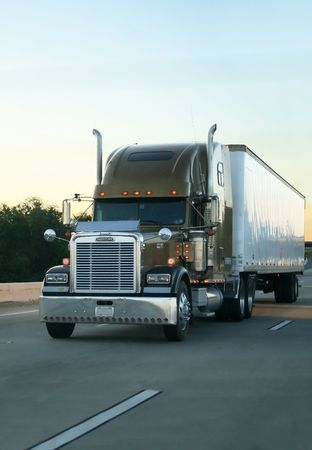 Big truck of load in movement on highway. Stock Photo