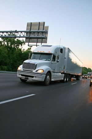 Big truck of load in movement on highway  Stock Photo
