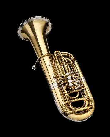 Tuba, wind instrument. On a black background