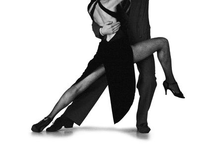 argentina dance: Young couple dancing Tango in the street