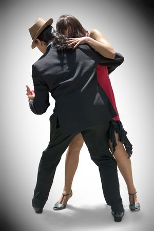 Young couple dancing Tango in the street