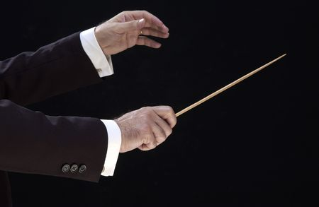 hands of the conductor, on black background