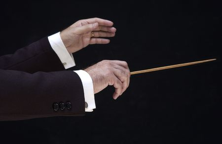 hands of the conductor, on black background Stock Photo - 5300133