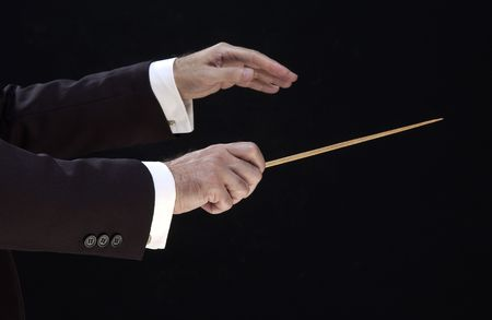 hands of the conductor, on black background Stock Photo - 5300138