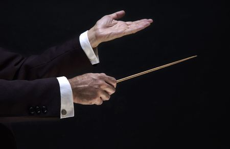 hands of the conductor, on black background                               photo
