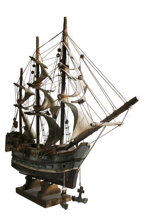 Old model of a sail boat in a white background