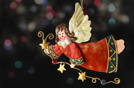 tinplate: Tinplate Angel, Christmas tree ornaments, with a background of blurry lights
