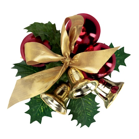 Christmas decoration with green leaves, red balls, bells, and gold ribbon, isolated on white. photo