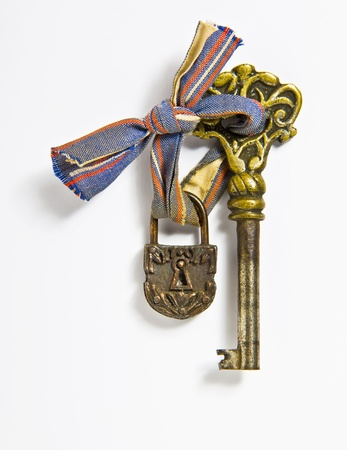 Little old lock and key on white background Stock Photo