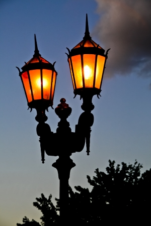 Lit old streetlamp at sunset in Argentine  Stock Photo