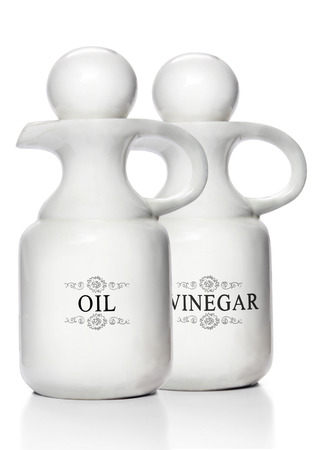 Olive oil and vinegar in pitchers ready for pouring.