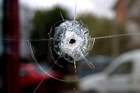 Glass window pierced by a shot