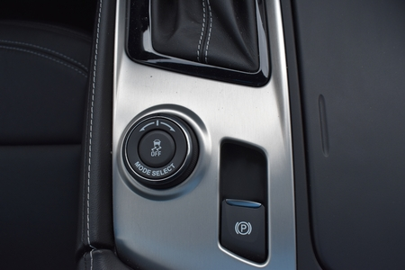 Interior sports car control buttons silver and black