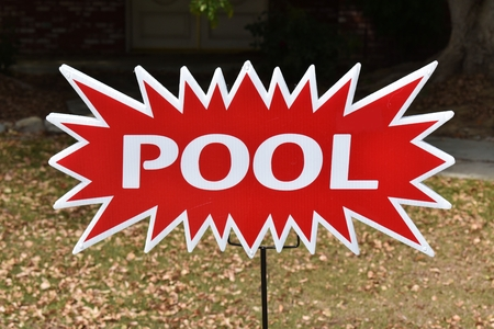 Bright red and white pool sign with a wow factor Stok Fotoğraf