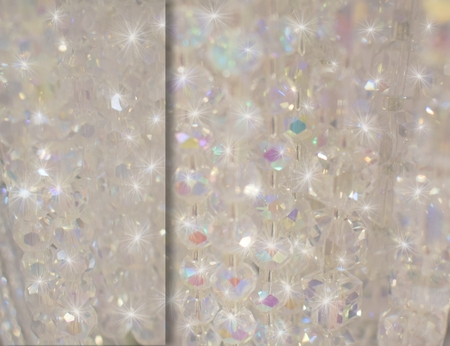 white sparkling clear beaded background with elegant gemstones