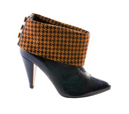 Orange houndstooth check and black leather high heels bootie isolated on white background  Clipping path included