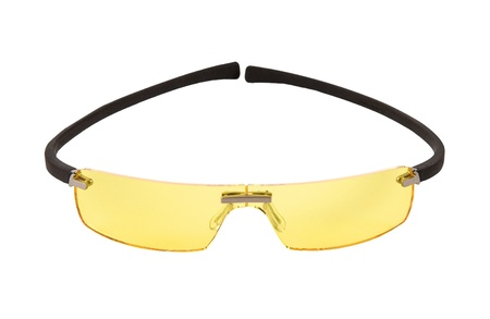 Sportive yellow light sunglasses isolated on white background. Clipping path included. Stock Photo