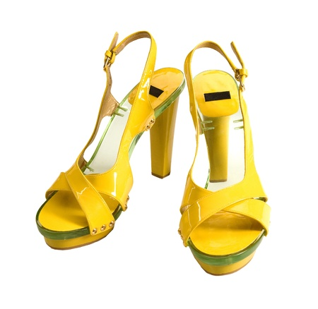 Transparent soled yellow patent leather high heels isolated on white background. Clipping path included. Stock Photo